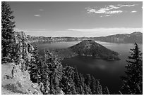 Visitor looking, Wizard Island and lake. Crater Lake National Park ( black and white)