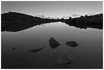 Rocks and calm lake with reflections, early morning, Dusy Basin. Kings Canyon National Park ( black and white)