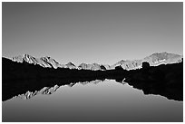 Mountain range reflected in calm lake, Dusy Basin. Kings Canyon National Park ( black and white)