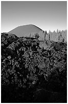 Fantastic lava beds and cinder cone, sunrise. Lassen Volcanic National Park, California, USA. (black and white)