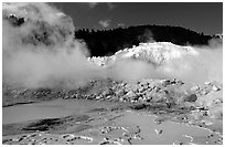 Mud cauldrons and fumeroles in Bumpass Hell thermal area. Lassen Volcanic National Park, California, USA. (black and white)