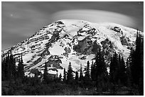 Mount Rainier capped by lenticular cloud, night. Mount Rainier National Park, Washington, USA. (black and white)