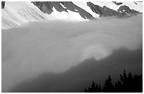 Sun projected on clouds filling Cascade River Valley,.  ( black and white)