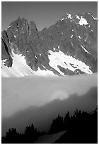 Peaks above fog-filled Cascade River Valley, early morning, North Cascades National Park.  ( black and white)