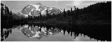 Mount Shuksan reflected in lake at sunset. North Cascades National Park (Panoramic black and white)