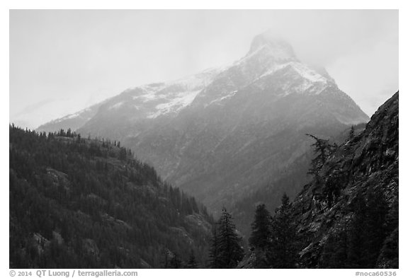 Snow-capped jagged peak in clouds, North Cascades National Park.  (black and white)