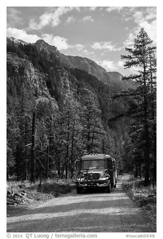 National Park shuttle bus on Stehekin Valley road, North Cascades National Park Service Complex.  (black and white)