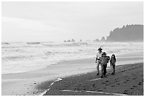 Family walking on Rialto Beach. Olympic National Park, Washington, USA. (black and white)