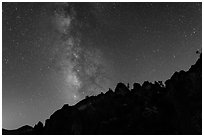 Rocky ridge and star-filled sky with Milky Way. Pinnacles National Park ( black and white)