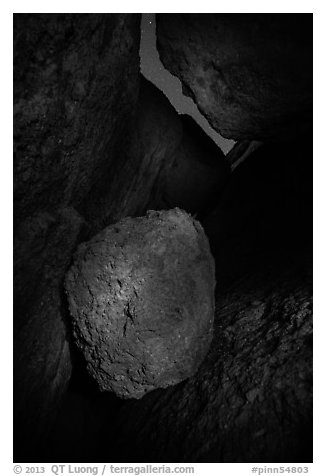 Boulder in Balconies talus cave at night. Pinnacles National Park (black and white)