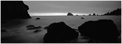 Boulders and seastacks and dusk. Redwood National Park (Panoramic black and white)