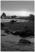 Stream on beach at sunset, False Klamath cove. Redwood National Park ( black and white)