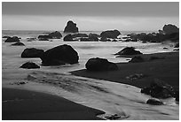 Stream, rocks, and ocean at dusk, False Klamath cove. Redwood National Park ( black and white)