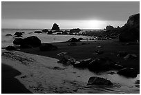 Stream reaches Pacific, False Klamath cove, sunset. Redwood National Park, California, USA. (black and white)