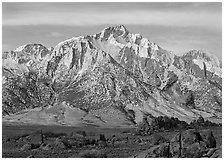 Volcanic boulders in Alabama hills and Lone Pine Peak, sunrise. Sequoia National Park, California, USA. (black and white)