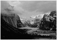 View with fog in valley and peaks lighted by sunset, winter. Yosemite National Park ( black and white)