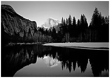 Half-Dome reflected in Merced River near Sentinel Bridge, sunset. Yosemite National Park ( black and white)