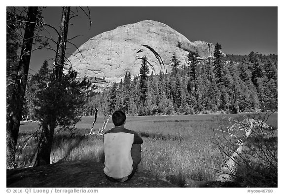 Hiker looking at backside of Half-Dome from Lost Lake. Yosemite National Park, California, USA.