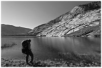 Park visitor with backpack looking, Merced Lake, morning. Yosemite National Park ( black and white)