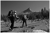 Women backpacking on John Muir Trail below Tressider Peak. Yosemite National Park, California, USA. (black and white)