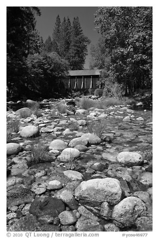 Pebbles in river and covered bridge, Wawona. Yosemite National Park (black and white)