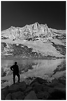 Hiker standing  on Roosevelt lakeshore. Yosemite National Park ( black and white)
