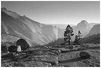 Erratic boulders, pines, Clouds rest and Half-Dome from Olmstedt Point, late afternoon. Yosemite National Park, California, USA. (black and white)