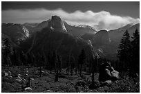 Half-Dome and plume of smoke from wildfire at night. Yosemite National Park ( black and white)