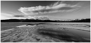 Snow-covered Twolumne Meadows and big cloud at sunset. Yosemite National Park, California, USA. (black and white)