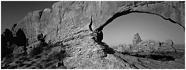 Arch through natural window opening. Arches National Park (Panoramic black and white)