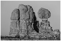 Balanced rock and sandstone tower. Arches National Park ( black and white)