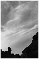 Sunset clouds and small balanced rock. Arches National Park ( black and white)