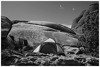 Tent with prayer flags amongst sandstone rocks. Arches National Park, Utah, USA. (black and white)