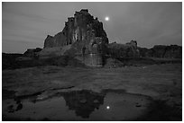 Courthouse tower and moon reflected in pothole. Arches National Park ( black and white)