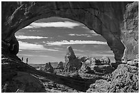 Family in the North Window span. Arches National Park ( black and white)