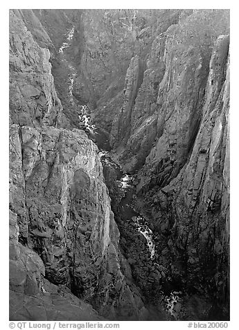View down steep rock walls and narrow chasm. Black Canyon of the Gunnison National Park (black and white)
