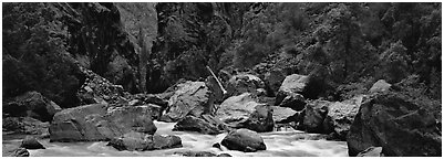 Gunnisson River and boulders in gorge. Black Canyon of the Gunnison National Park (Panoramic black and white)