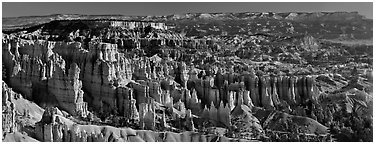 Densely aligned pinnacles in horseshoe-shaped amphitheaters along edge of Pausaugunt Plateau. Bryce Canyon National Park (Panoramic black and white)