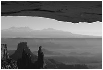 Mesa Arch, pinnacles, La Sal Mountains, early morning, Island in the sky. Canyonlands National Park, Utah, USA. (black and white)