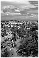 Hikers on the Chesler Park trail, the Needles. Canyonlands National Park, Utah, USA. (black and white)