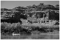 Canoeists and cliffs, Colorado River. Canyonlands National Park, Utah, USA. (black and white)