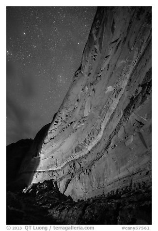 Illuminated canyon wall with rock art under starry sky, Horseshoe Canyon. Canyonlands National Park, Utah, USA.