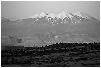 Distant Island in the Sky cliffs and La Sal mountains. Canyonlands National Park, Utah, USA. (black and white)
