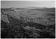 Cliffs, basin, and snowy mountains at dusk, Upper Desert, dusk. Capitol Reef National Park ( black and white)