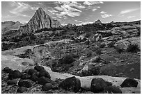 Black volcanic boulders and Pectol Pyramid. Capitol Reef National Park ( black and white)