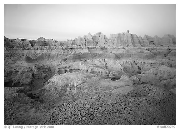 Cracked mudstone and eroded towers near Cedar Pass, dawn. Badlands National Park, South Dakota, USA.