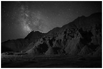 Starry sky and Milky Way above buttes. Badlands National Park ( black and white)