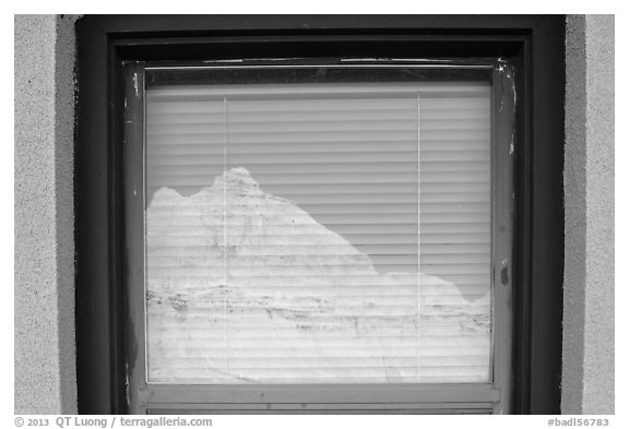 Butte, Window reflexion, Badlands National Park Headquarters. Badlands National Park, South Dakota, USA.