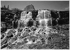 Waterfall at hanging gardens, with top of Mountain. Glacier National Park ( black and white)