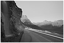 Roadside waterfall and light trail, Going-to-the-Sun road. Glacier National Park, Montana, USA. (black and white)
